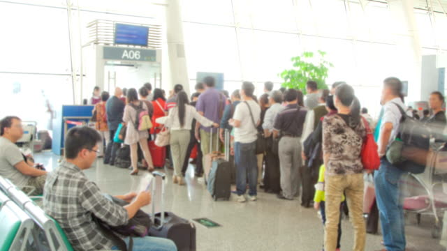 Traveler Crowd at Airport gate before boarding time lapse video