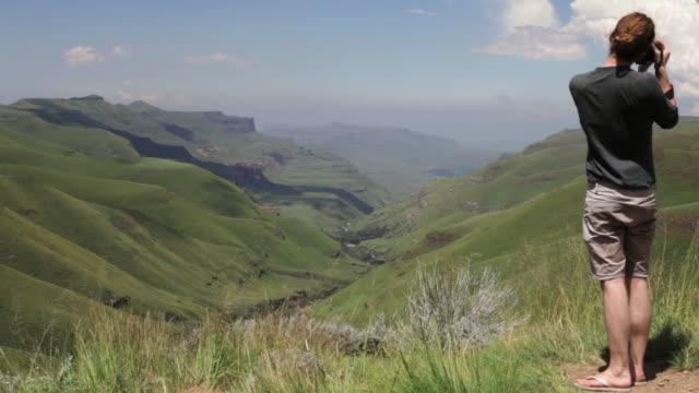 Traveler enjoying view over Sani Pass video