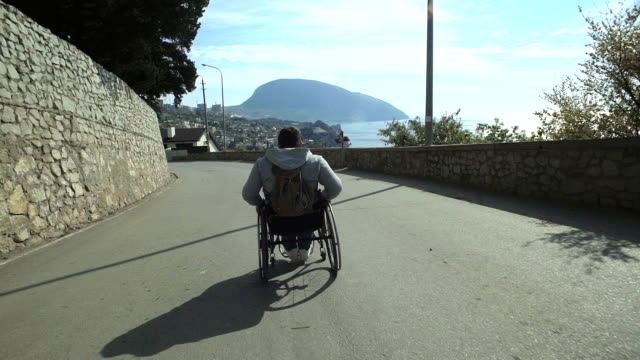 Traveler Man In Wheelchair Walk By Road video