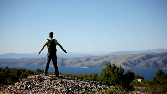 Traveler on a mountain top video