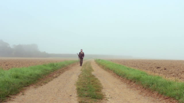 Traveler walks out of mist. Part of my Journey Collection video