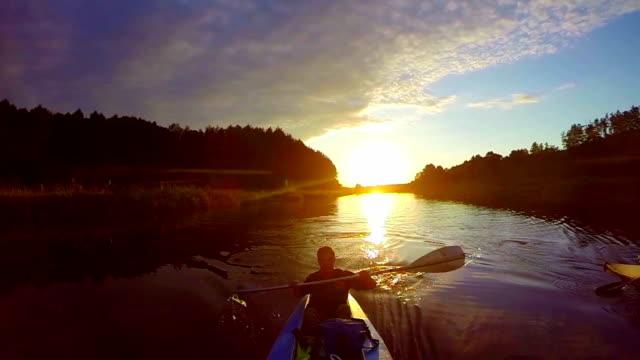 Travelers kayaking at sunset, breathtaking view, sport, slow-mo video