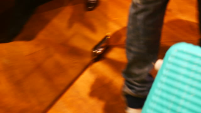 traveler's legs  legs while walking and drag blue baggage video