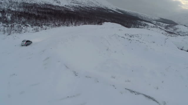 Traveling in winter mountains, aerial view video