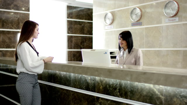 traveller paying for appartament in the hotel at the reception video