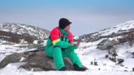Traveller using smart phone on mountain video