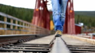 Traveller walking on railroad track video