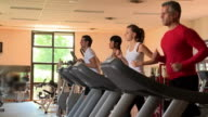 Treadmill exercises at gym video