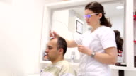 Treatment and stimulation of hair growth. video