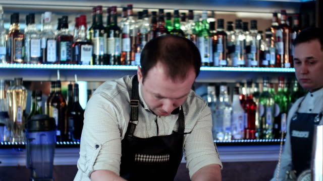 Tree bartenders working in a bar video