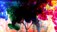 Tree blossom in full bloom with abstract vibrant mixture of colored ink clouds video