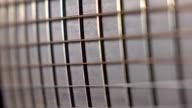 Trembling guitar strings against fret. Music performance. FullHD macro video video