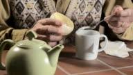 trembling hands making tea video