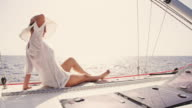 SLO MO Trendy woman enjoying the wind on a sailboat video