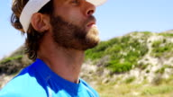 Triathlete man exercising on a sunny day video