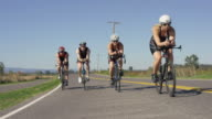 Triathletes training for a triathlon video