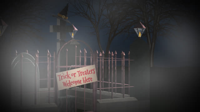 Trick or Treat sign on the gates of a graveyard video