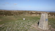 Trig point Black Down Mendip Hills Somerset countryside ngland UK PAN video