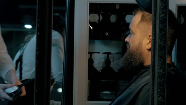 Trimming beard in barbershop video