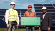 Trio of solar panel engineers outside video