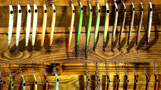 Triple hooks and colorful fishing lures in the sporting goods store video