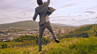 SLO MO Triumphant businessman jumping and punching the air video