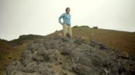 Triumphant hiker at the top video