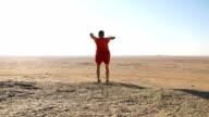 SLO MO FL Triumphant Man In Desert video