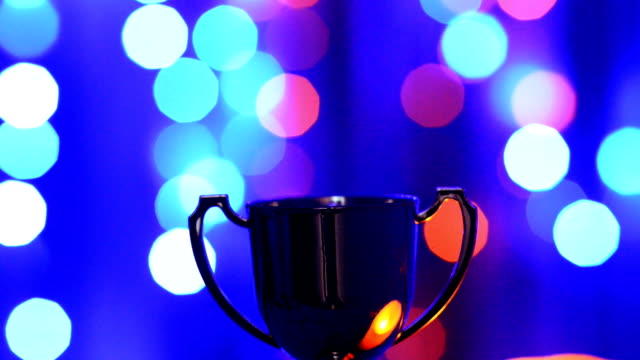 Trophy cups on defocusd abstract background video