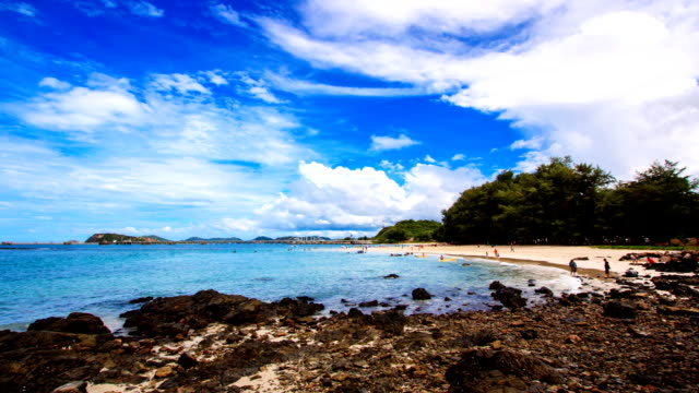 Tropical beach with rocks and clear sky. video