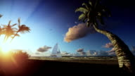Tropical island, palm trees blowing in the wind and yacht sailing at sunrise video