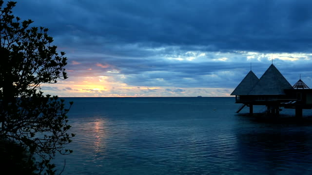 Tropical Paradise Luxury Over Water Resort at Sunset video