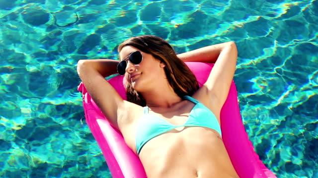 Tropical Resort Vacation. Bikini Woman Sunbathing video