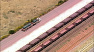 truck alongside train - Aerial View - Western Cape,  West Coast District Municipality,  Cederberg,  South Africa video