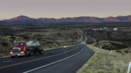 Truck and Motorbike on Lonely Desert Road video