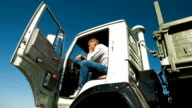 Truck Driver in Cab Using Mobile Phone video