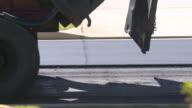 Truck Dumping Asphalt Remains on Road video