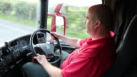 Truck / Lorry driver in cab, driving on the road video