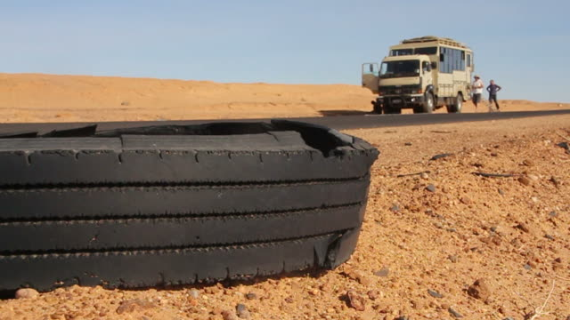 Truck & tire at roadside in Nubian Desert of Sudan video