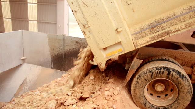Truck Unloading Stones From Its Dumper video
