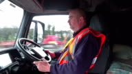 4K: Truck / Wagon driver in his cab driving video