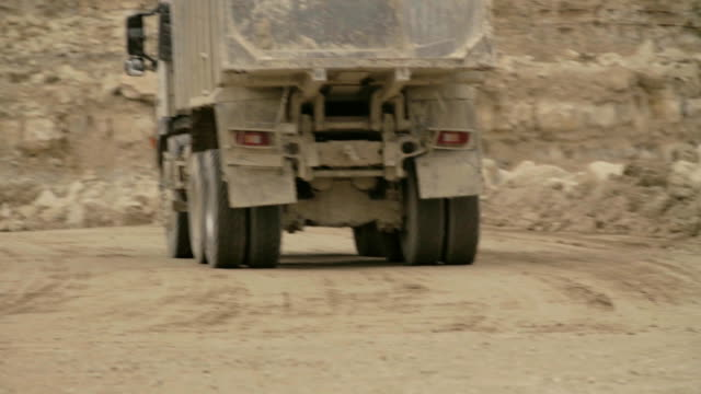 Truck's wheels on a dirt road. video