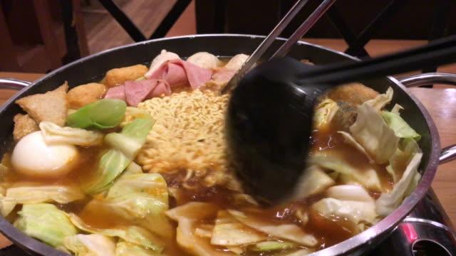 Tteokbokki , Korean noodle hot pot , Bangkok , Thailand. video