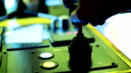 Tug master controls pilot engine. Close-up of hands in a low light video