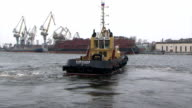 Tug-boat floats on the river. video