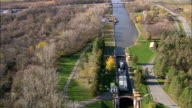 Tugboat In Lock 20 State Canal Park  - Aerial View - New York,  Oneida County,  United States video