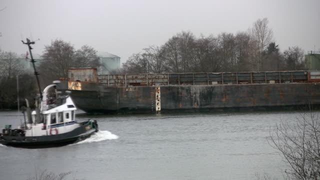 Tugboat passes. video