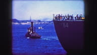 1944: Tugboat pulling USS General William Mitchell (AP-114) troopship maiden voyage. video