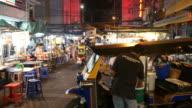 Tuk Tuk and food vendors in China Town video