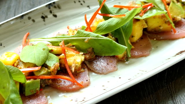 Tuna with avocado and mango on top video